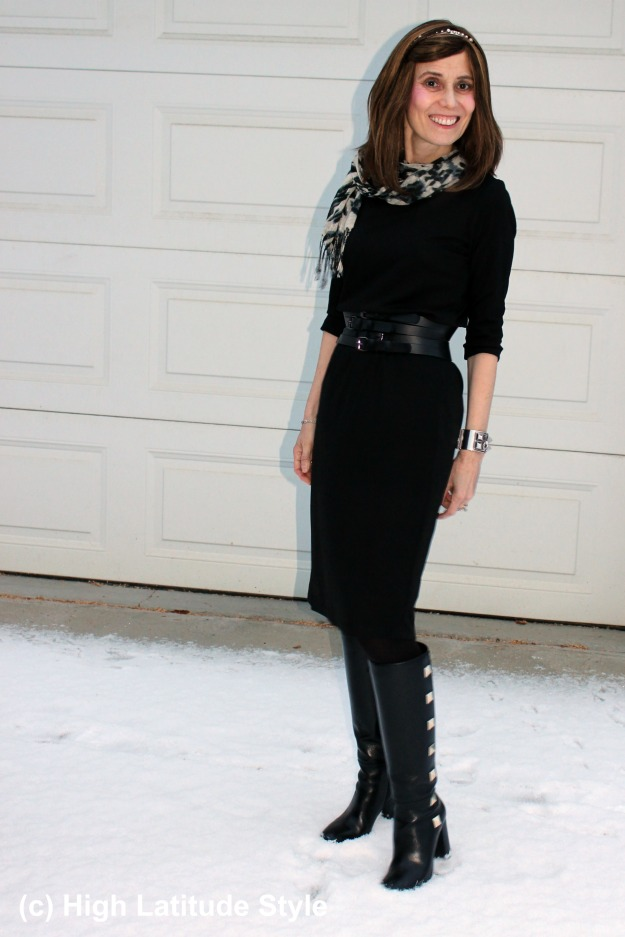 fashion blogger in LBD with tall statement studded boots