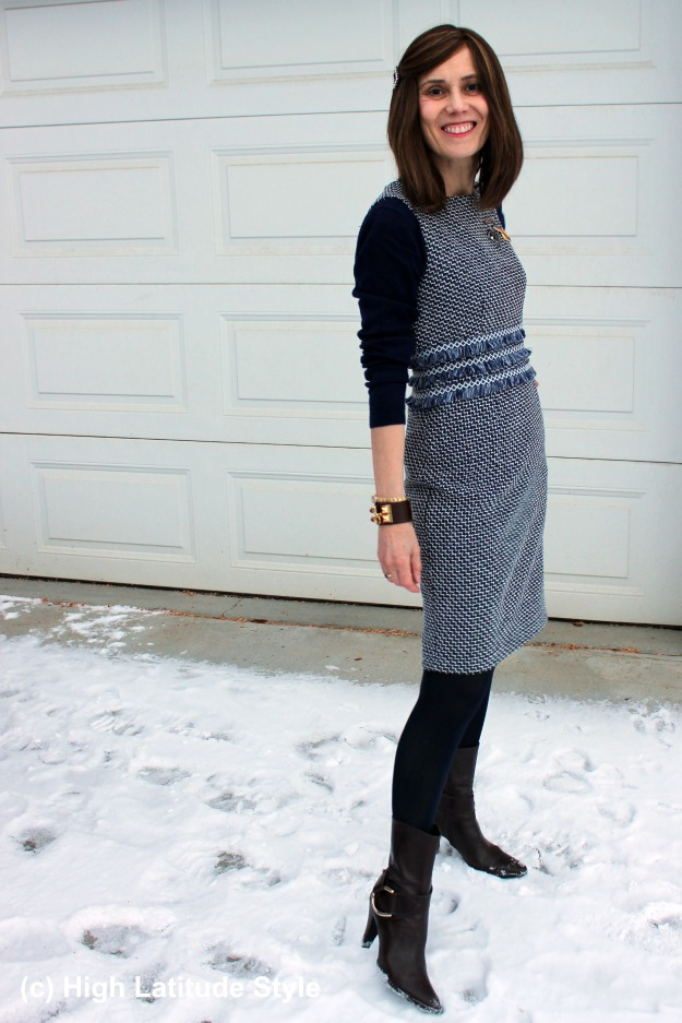 over 50 years old fashion blogger wearing a chic sheath dress with sweater