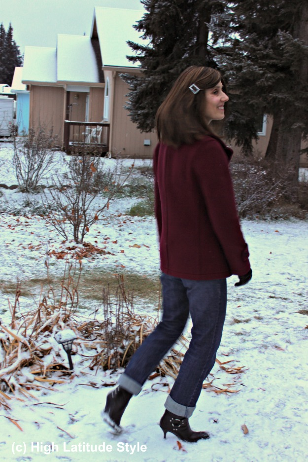 #over50fashion woman in classic outerwear with pea-coat, jeans, and motorcycle booties