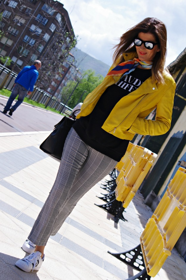 over 50 years old Spanish fashion blogger Carmen Gimeno in yellow leather and Glen-check pants