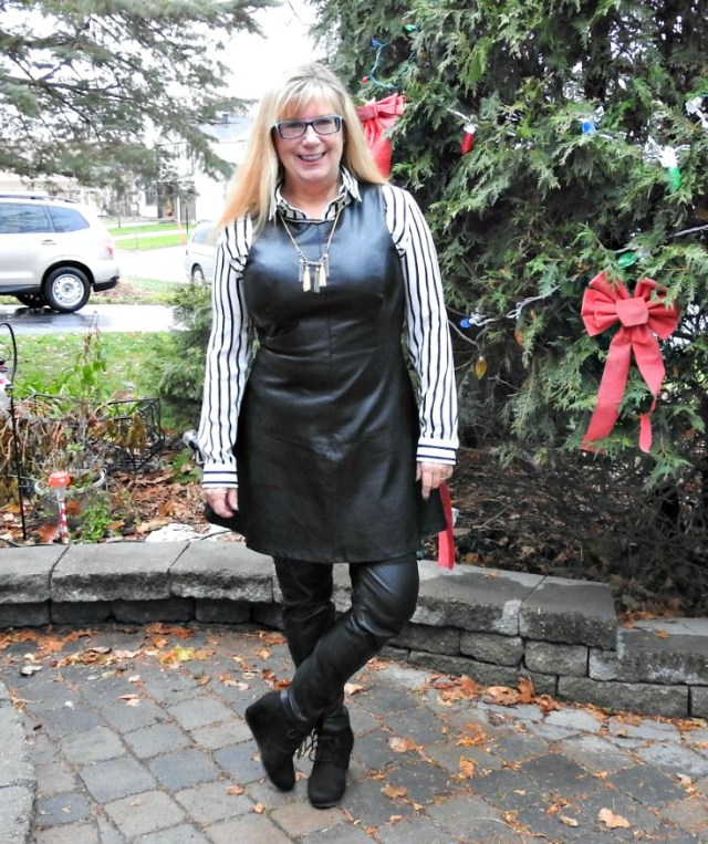 midlife woman in leather pants and dress