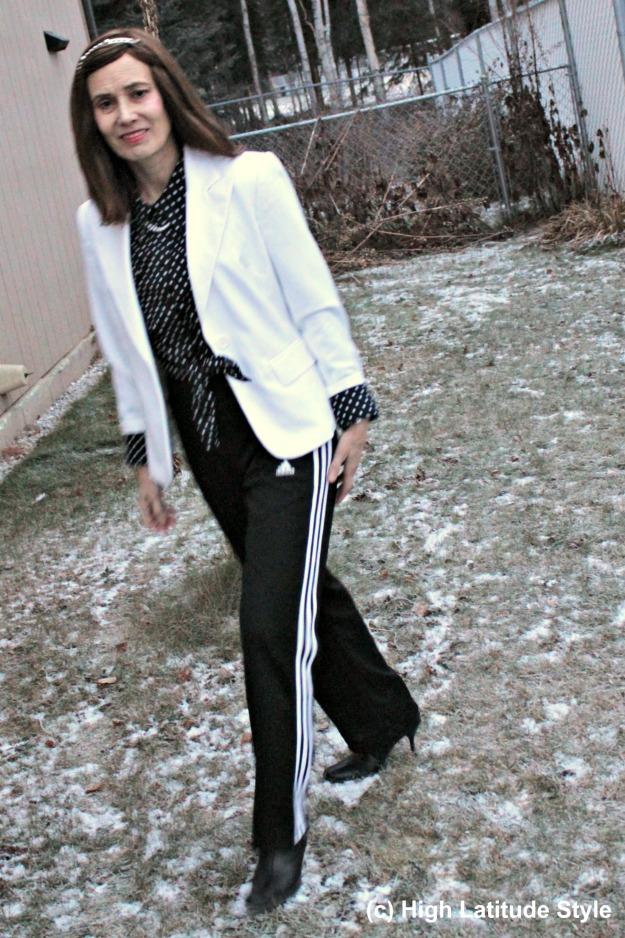 midlife woman in polka dot shirt and striped pants