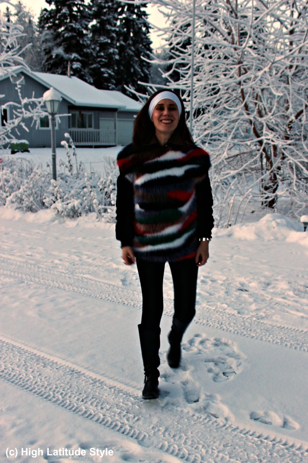 #maturefashion woman in riding boots and sweater in the snow