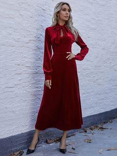 red tea-length bow velvet dress