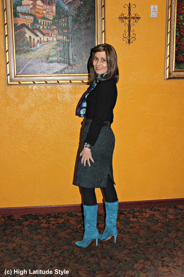 mature woman in winter going out look with tall footwear