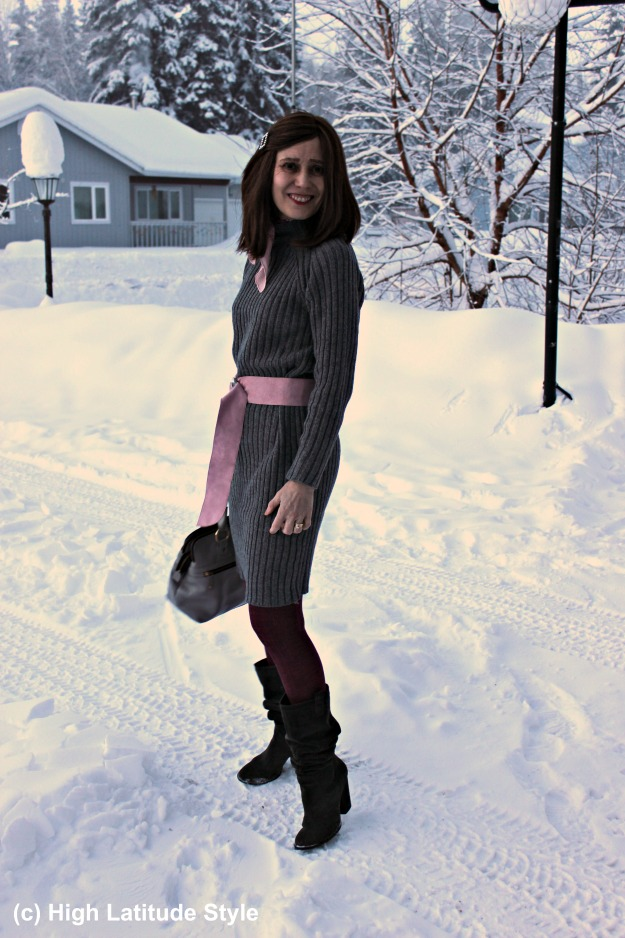 gray knit dress over 50 with pink belt
