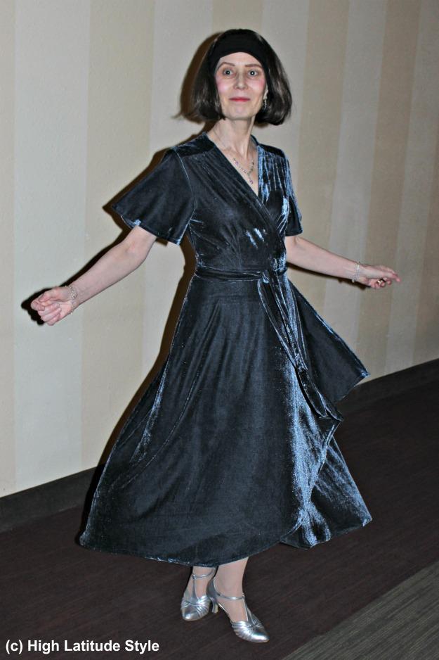 #midlifefashion woman in high-low hem velvet maxi dress illustrating the twirl