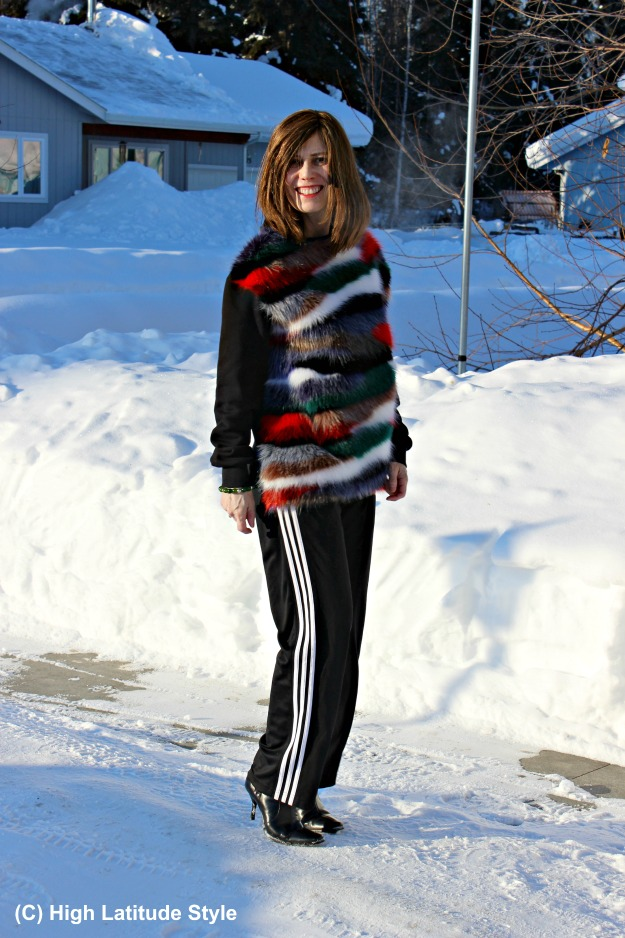fashion blogger over 40 in Casual Friday outfit with sport pants and faux fir sweater