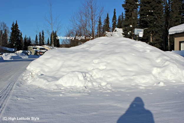 snow pile at a driveway in College, Alaska on March 19, 2017
