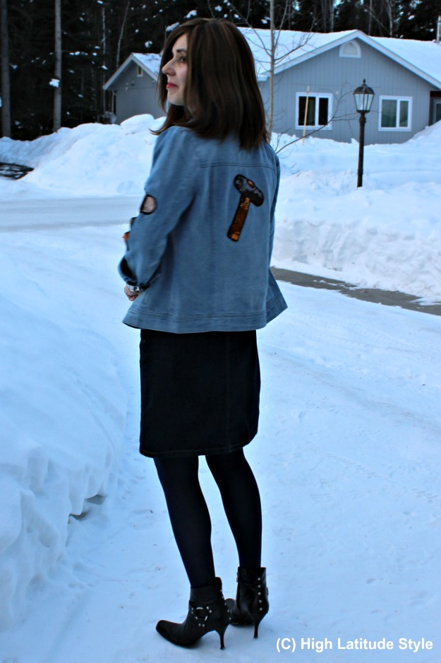 fashion blogger over 50 in denim-on-denim with sequin patches to look young and hip