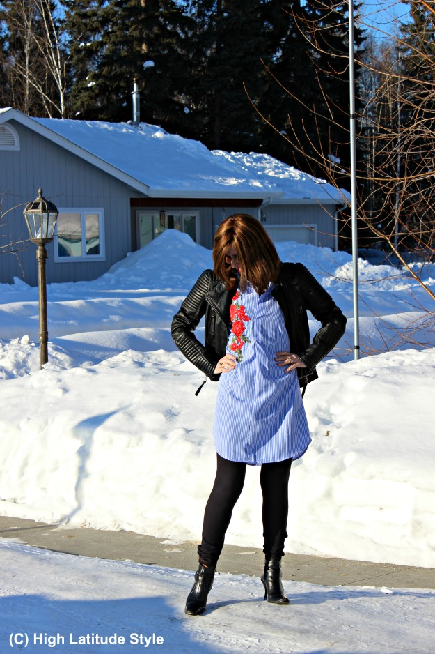 fashion over 40 woman posing in front of a snowpack