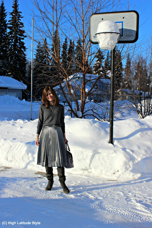 styleover40 woman in pleated silver metallic skirt and sweater
