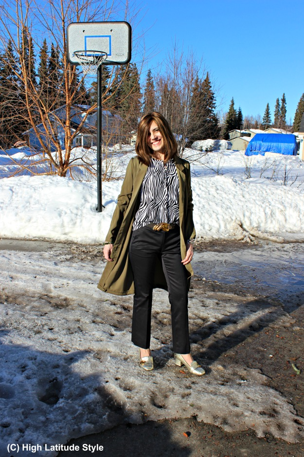 fashion over 40 woman in Alaska spring outfit with zebra print top