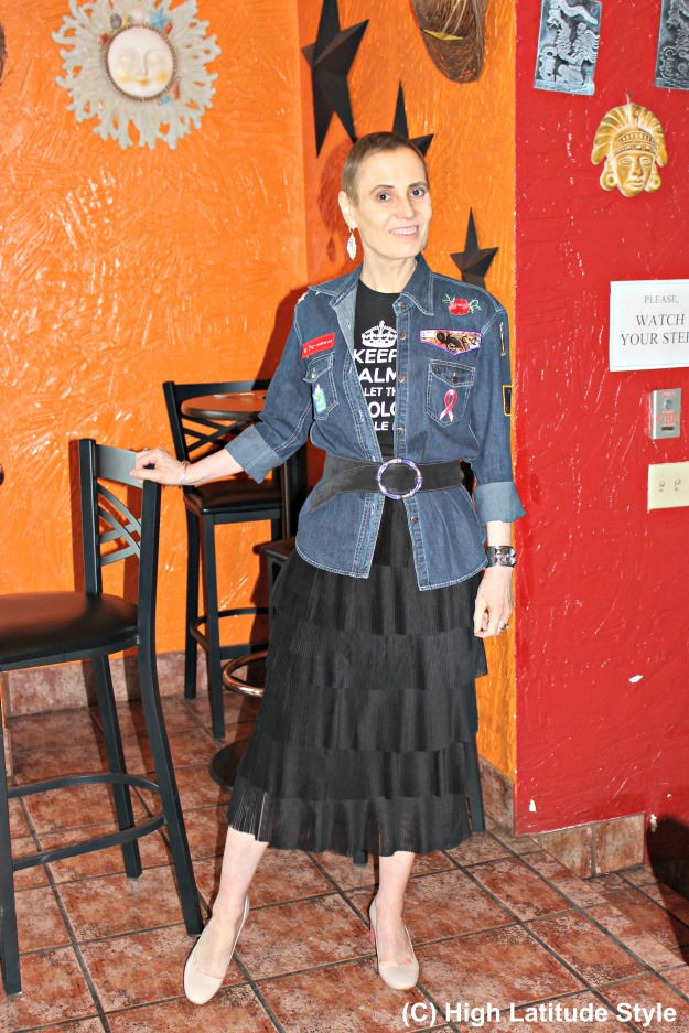 style blogger over 50 in denim top and pleated skirt