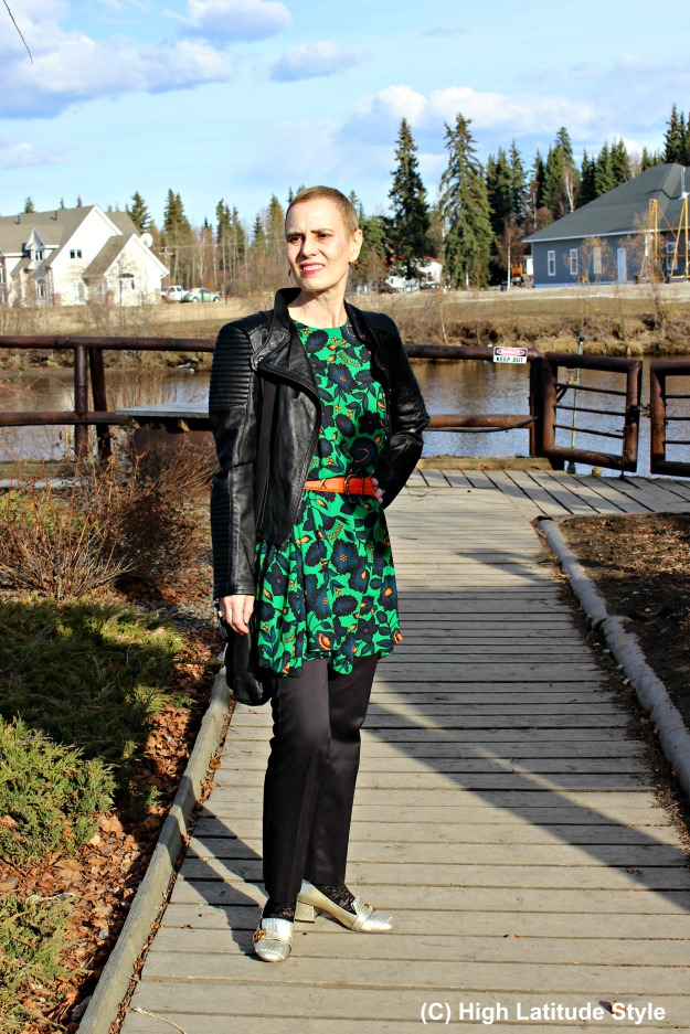 #fashionover40 woman in floral dress with black pants