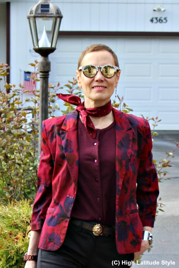 #advancedfashion woman in floral blazer with wooden frame sunnies