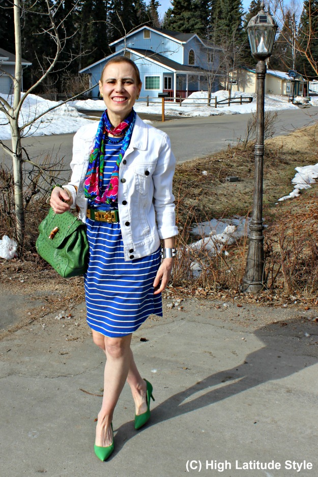 over 50 years old fashion blogger in striped dress with floral scarf and denim