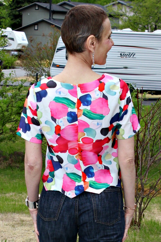 mature woman wearing a cropped floral print top