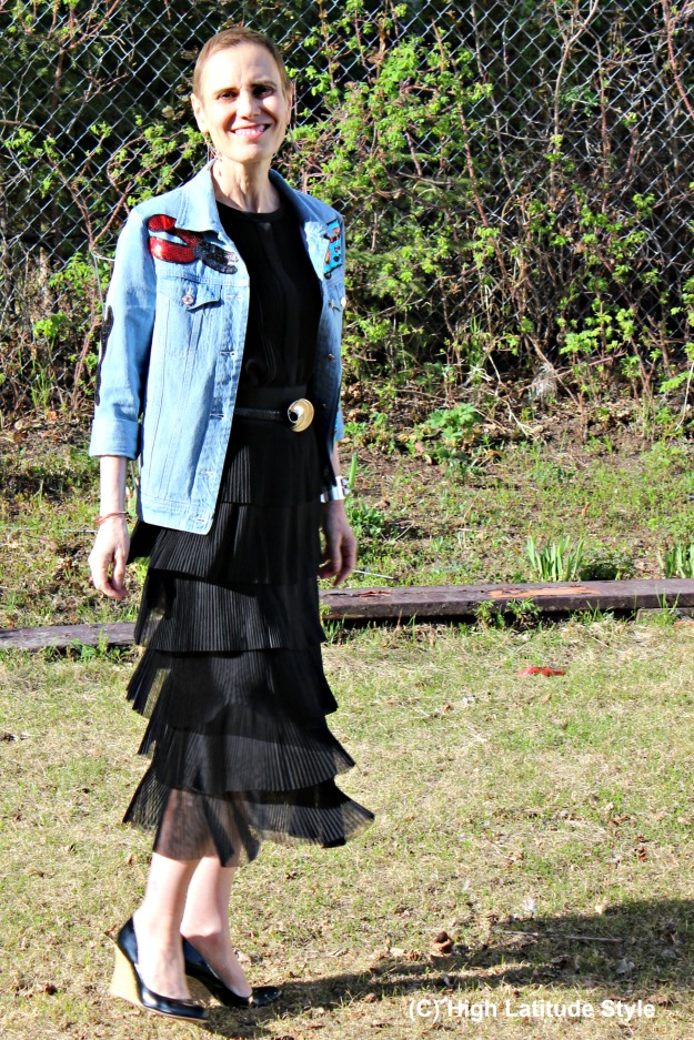 Alaskan fashion blogger in black outfit with sequin denim jacket
