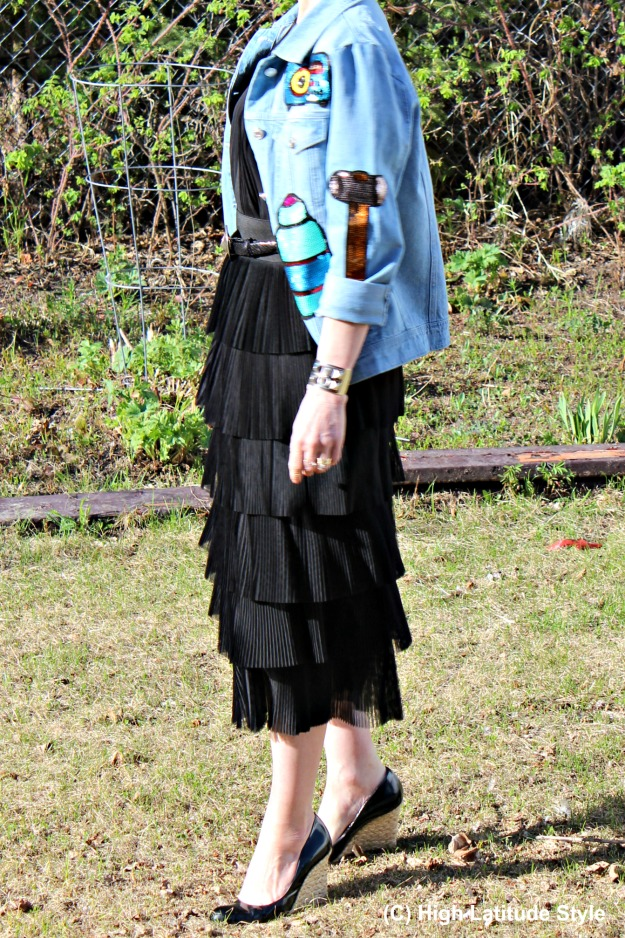 #over50fashion style blogger Nicole in a tiered skirt with sequin patch denim jacket in Alaska
