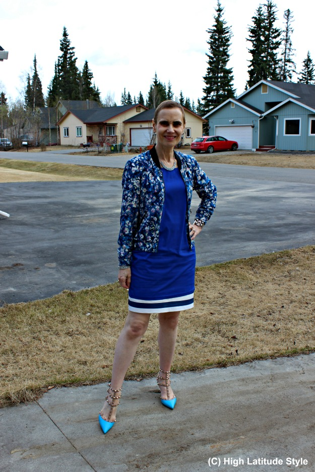 fashion over 40 woman wearing a dress over a skirt showing no cold shoulder