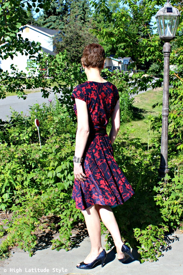 fashion blogger over 50 in red-blue floral dress and open toe-pumps