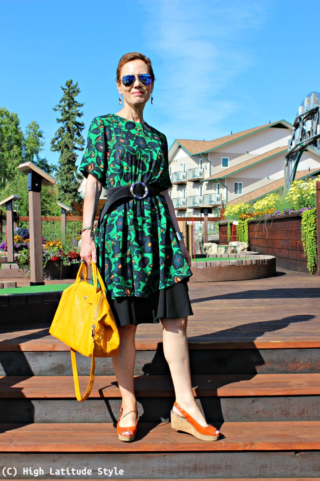 over 50 years old style blogger in floral dress over skirt