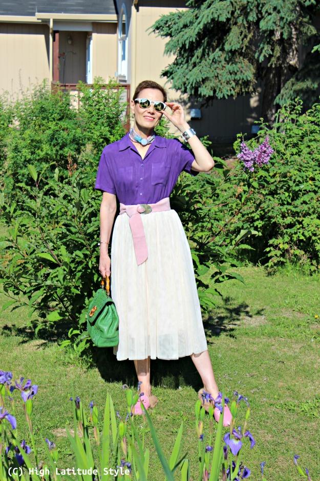 fashion over 40 woman purple blouse and blush mesh skirt