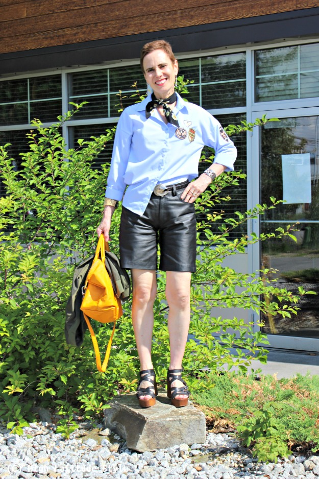 fashion blogger over 40 in leather shorts with shirt