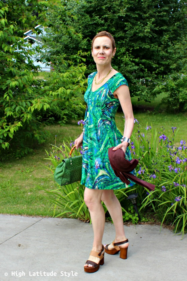 style blogger in green end of summer dress with knir jacket