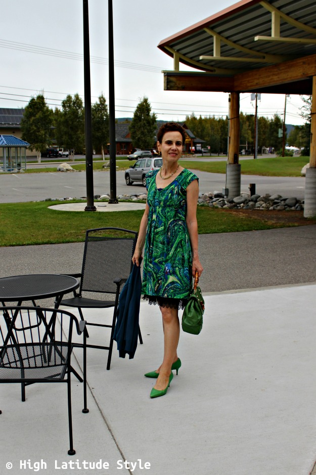#fashionover40 woman in green print dress with cardigan