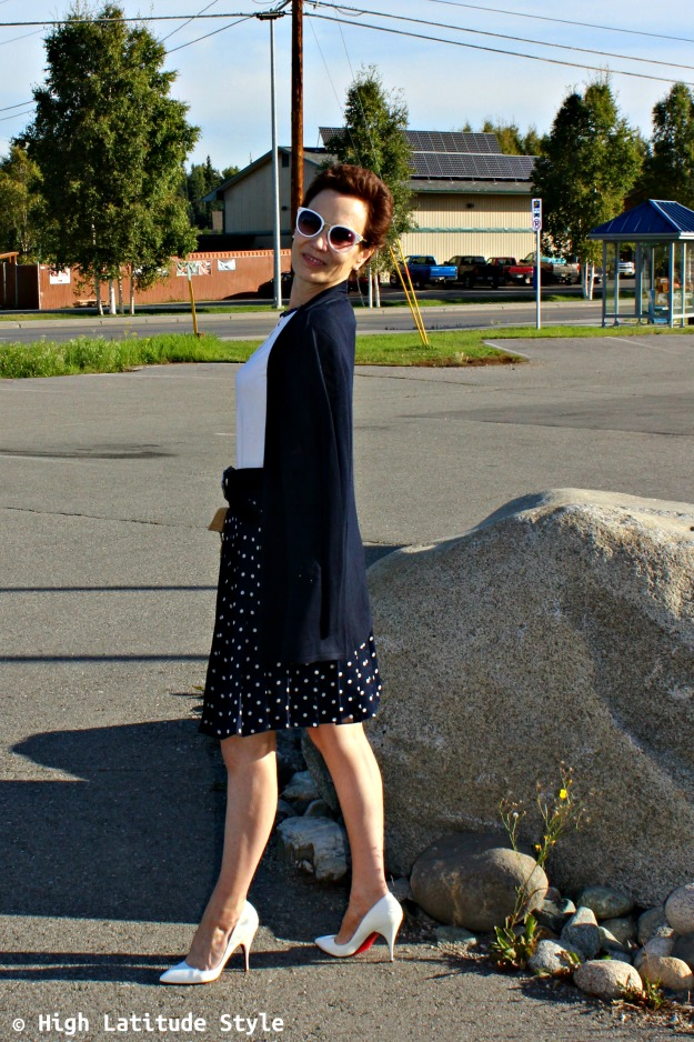 fashion blogger presenting the fall trend polka dots styled for work