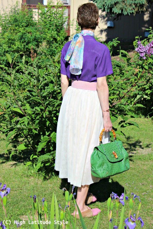stylist in summer blush skirt, purple shirt with colorful scarf