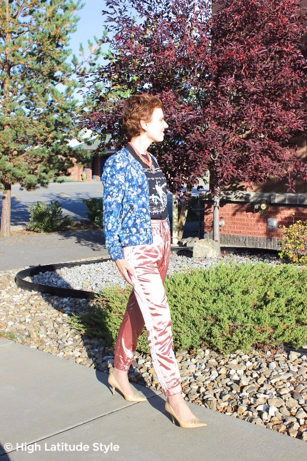 mature woman in athleisure pants with floral print jacket