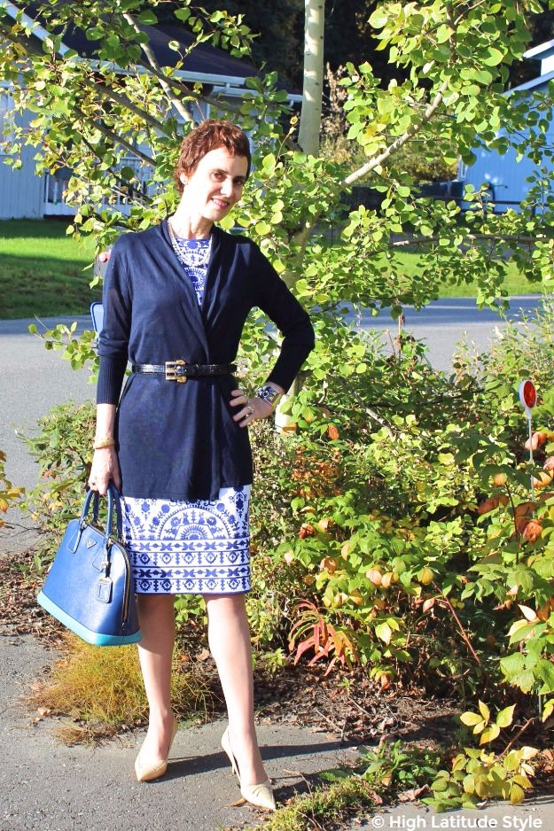style book author wearing a cardigan over blue and white sheath