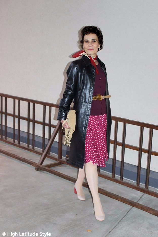 #trendsover50 woman in dress worn as skirt and cardigan with leather coat
