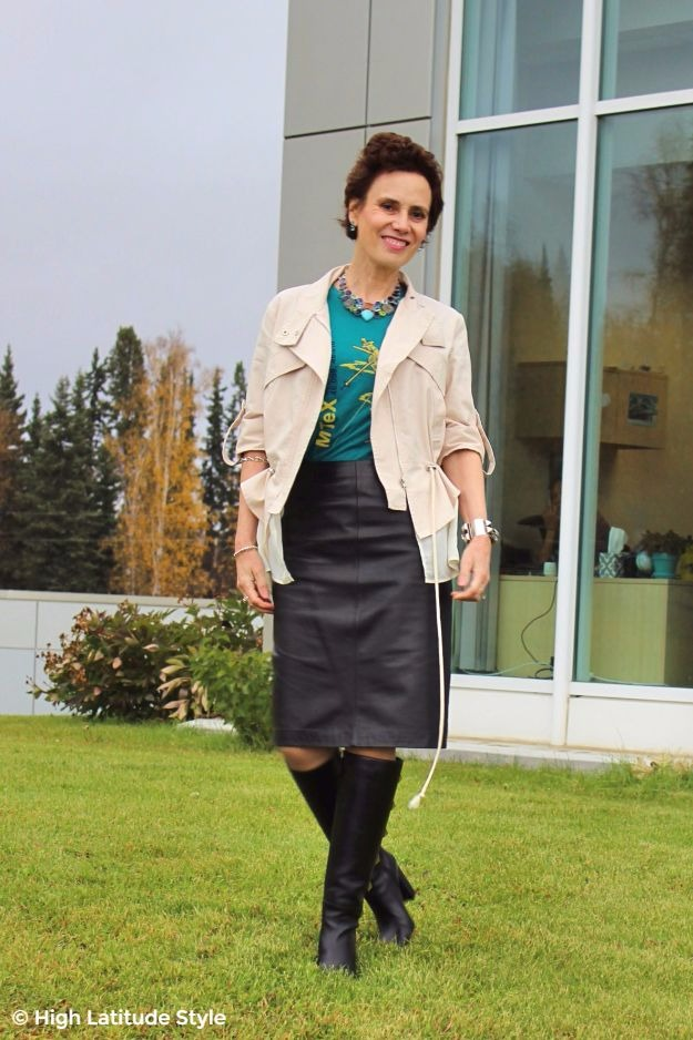 #midlifefashion woman in leather, graphic T-shirt and knee-high boots