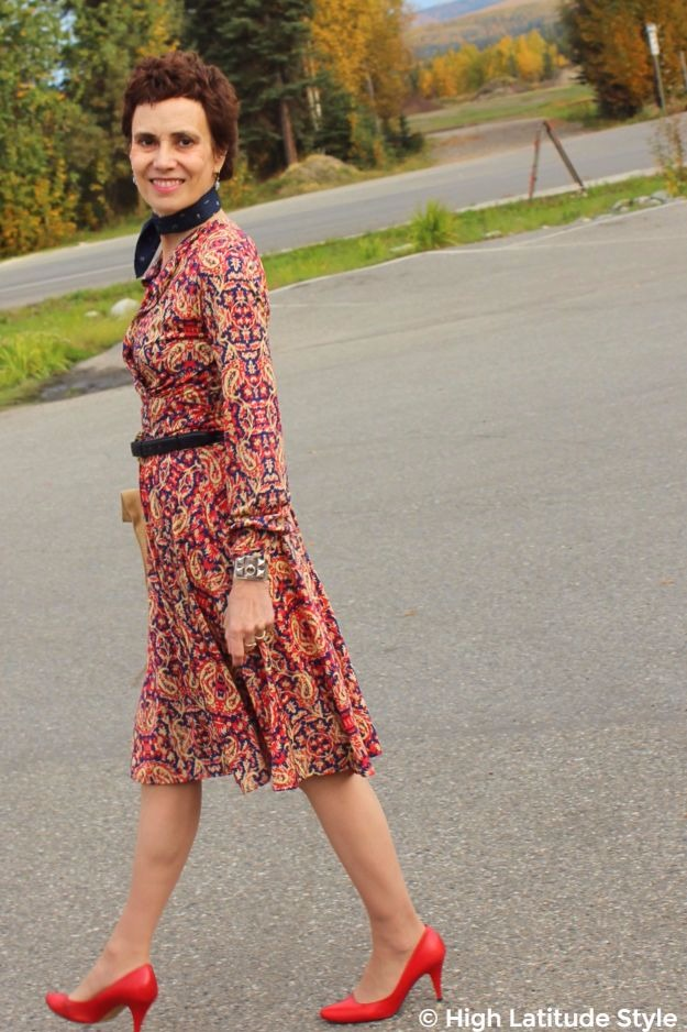 #fashionover40 middle-aged woman in printed fit-and-flare dress