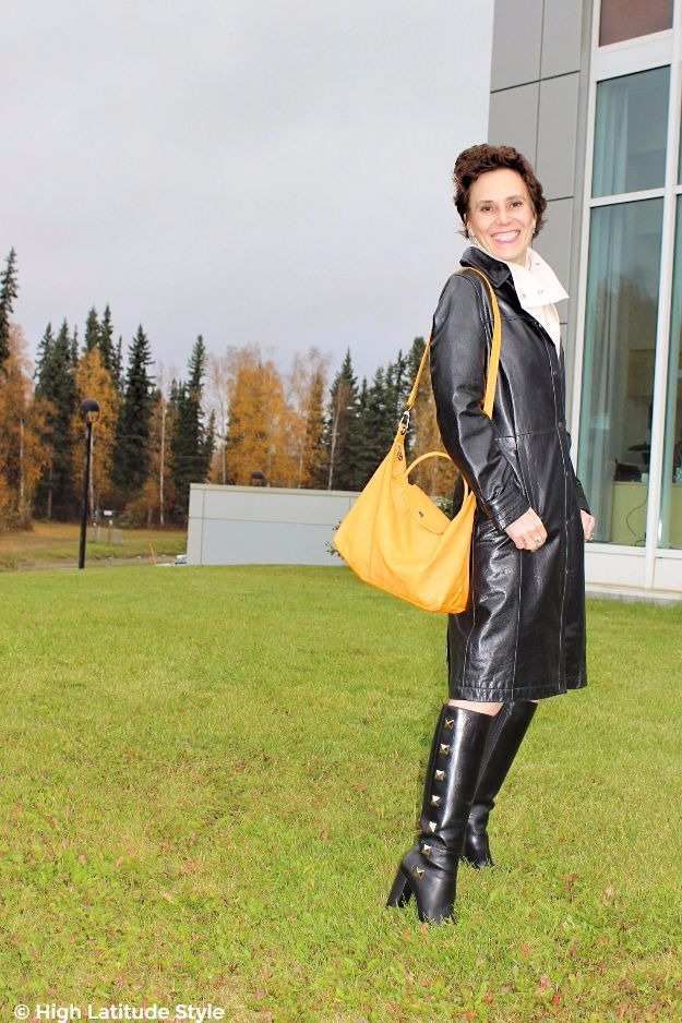 midlife blogger in outfits with studded footwear, leather skirt, nappa coat and yellow bag
