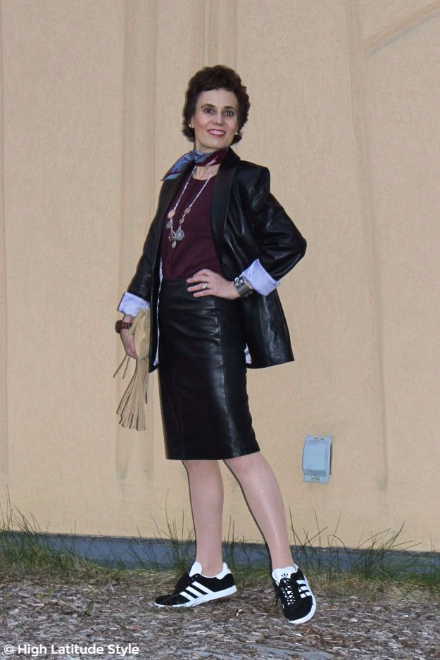 older woman in posh leather skirt suit