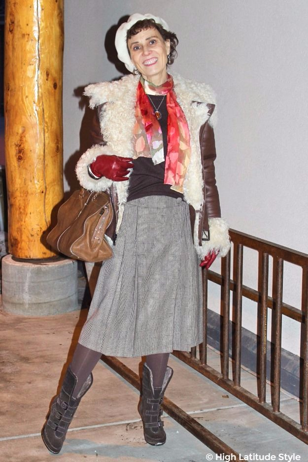 stylist in Posh chic winter outerwear with colorful scarf