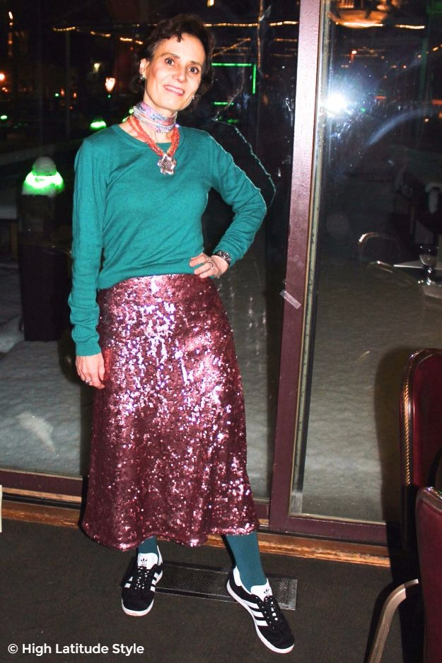 midlife woman in Alaska street style with pink sequin skirt and teal sweater