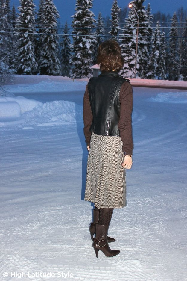 #styleover50 back view of a posh casual work look with wool skirt and motorcycle vest