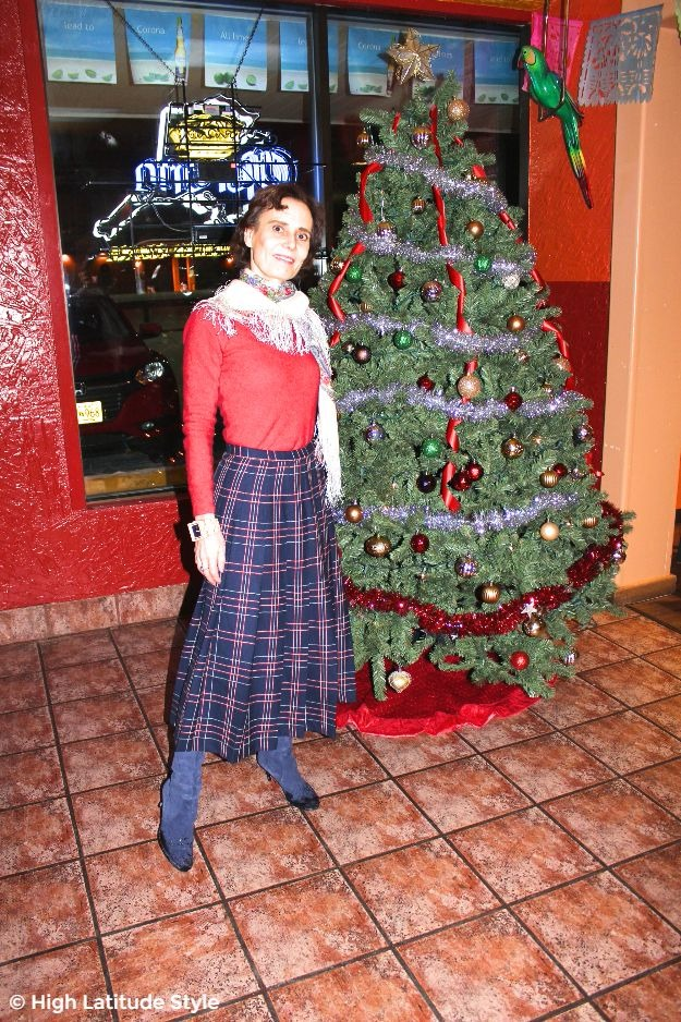 #midlifestyle woman in Christmas outfit with plaid skirt and Russian scarf