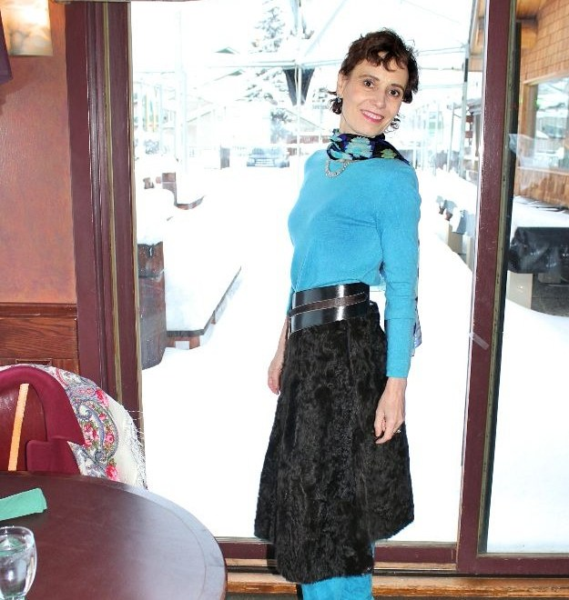 #fashionover40 woman looking posh in turquoise Jimmy Choo boots
