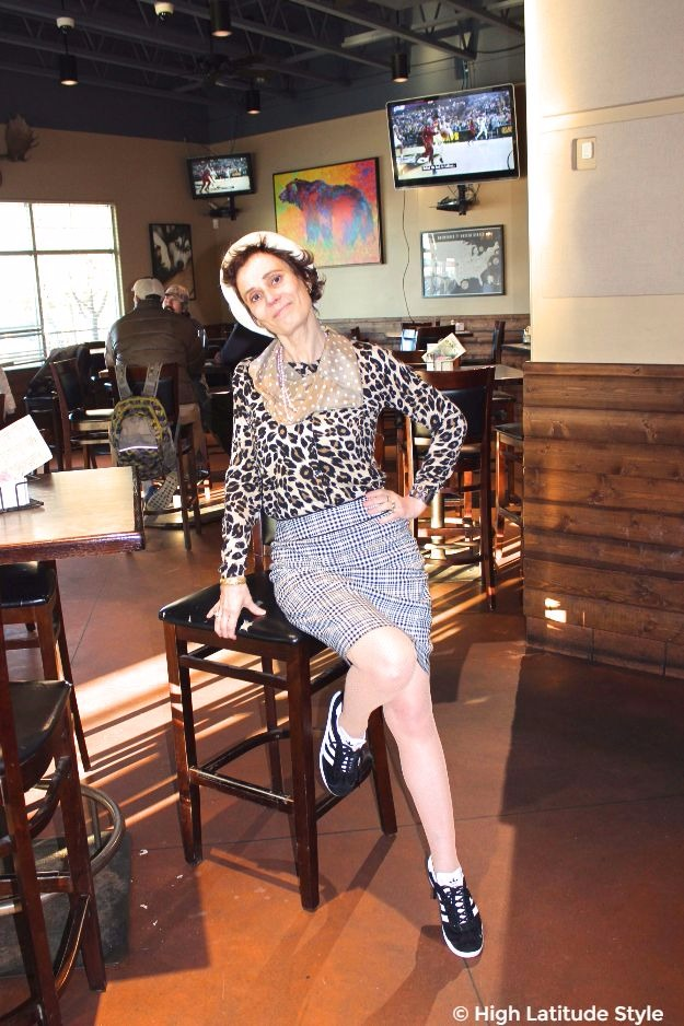 #advancedstyle #fashionover50 woman in chic pattern mix of polka dots, hounds tooth and leopard