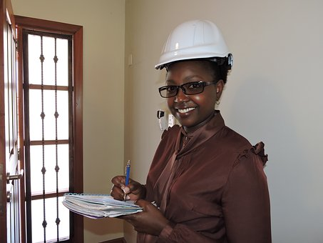 #femaleengineer female engineer in solid neutral color tailored blouse and hard hat