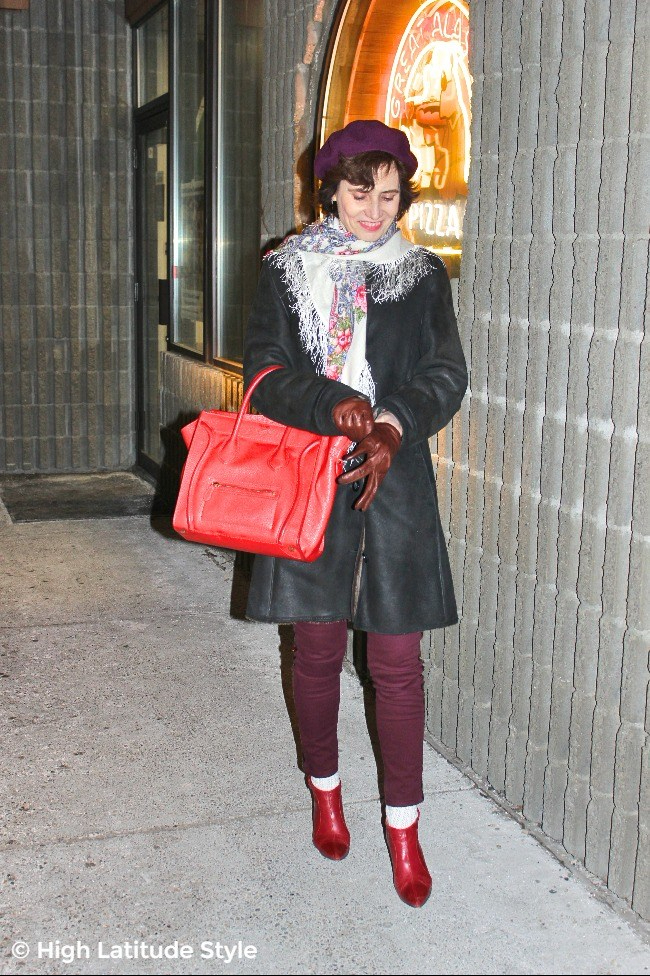 fashion blogger looking posh with gauntlet in winter outfit in a mall