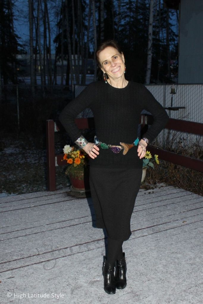 mature woman in cold weather office outfit in black knits and tights with belt