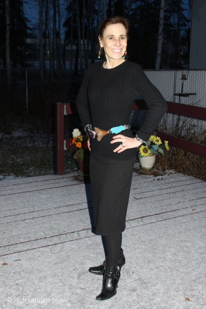 style book author in all black winter clothes with colorful statement belt